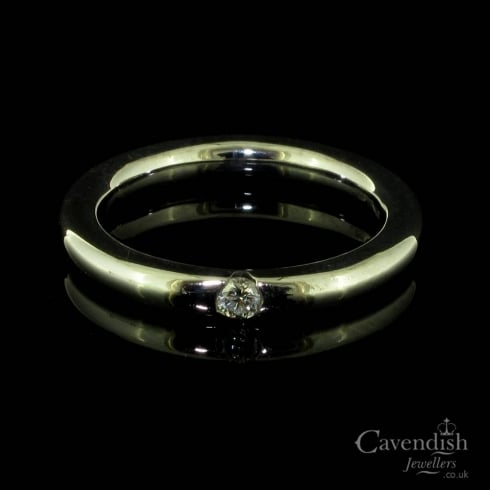 Charming White Gold and Diamond Solitaire Band