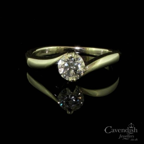 Contemporary Platinum and Diamond Twist Solitaire Ring