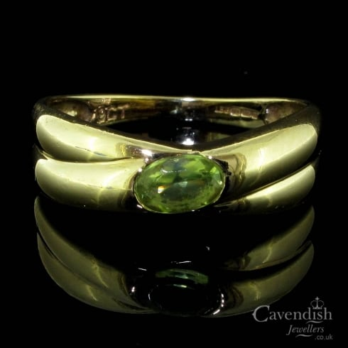 Delightful 9ct Gold And Peridot Crossover Style Ring