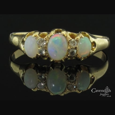 Desirable Gold, Diamond and Opal Three Stone Ring