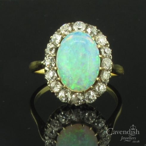 Edwardian Yellow Gold, Opal And Diamond Oval Cluster Ring