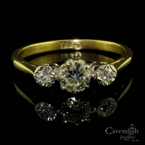 Elegant Yellow Gold Diamond Trilogy Ring