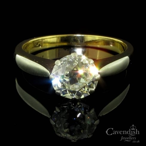 Enticing Gold, Platinum And Old Cut Diamond Solitaire Ring