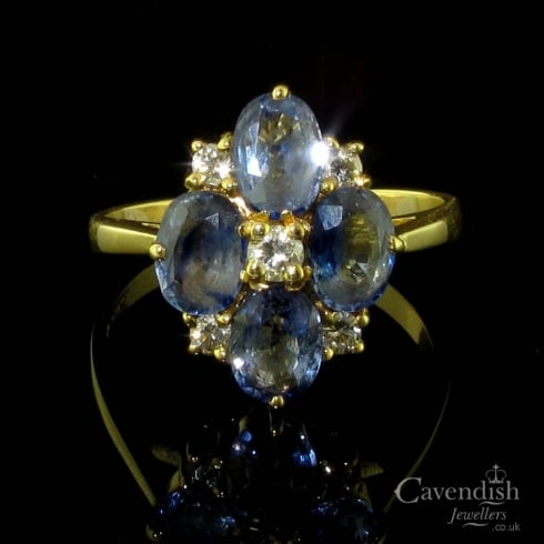 Impressive 18ct Gold Tanzanite & Diamond Cluster Ring