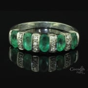 Individual White Gold, Emerald & Diamond Half Hoop Ring