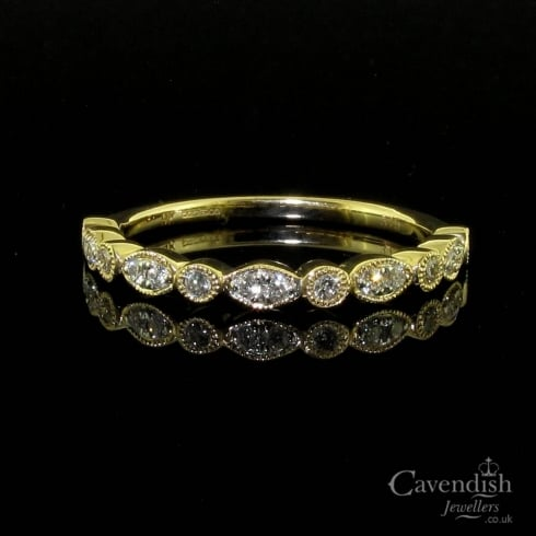 Interesting 9ct Gold Diamond Half Eternity Ring