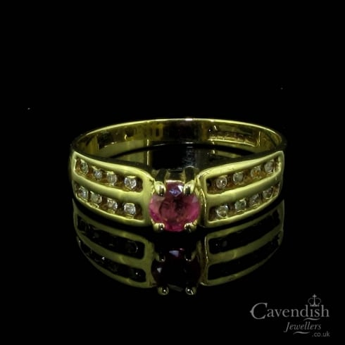Interesting 9ct Gold Ruby & Cubic Zirconia Solitaire Ring