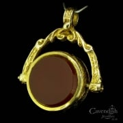 Pleasing Gold Onyx and Carnelian Spinner Fob