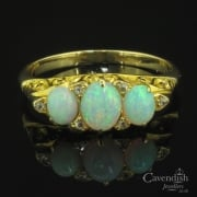 Remarkable Gold Opal and Diamond Trilogy Ring