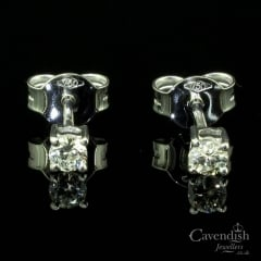 Spectacular White Gold And Diamond Single Stone Stud Earrings