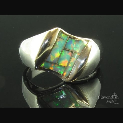 Striking Synthetic Opal Ring Set In Silver