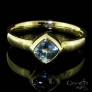 Understated 9ct Gold And Blue Topaz Single Stone Ring